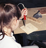 Young woman working on her hundred dots